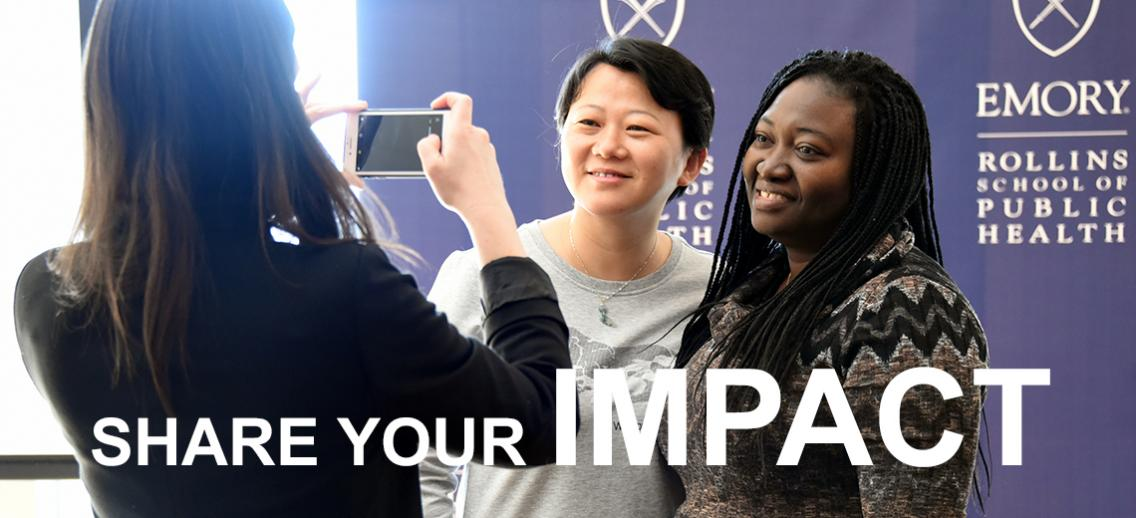Share you Impact - Two scholars smiling and posing for a photo